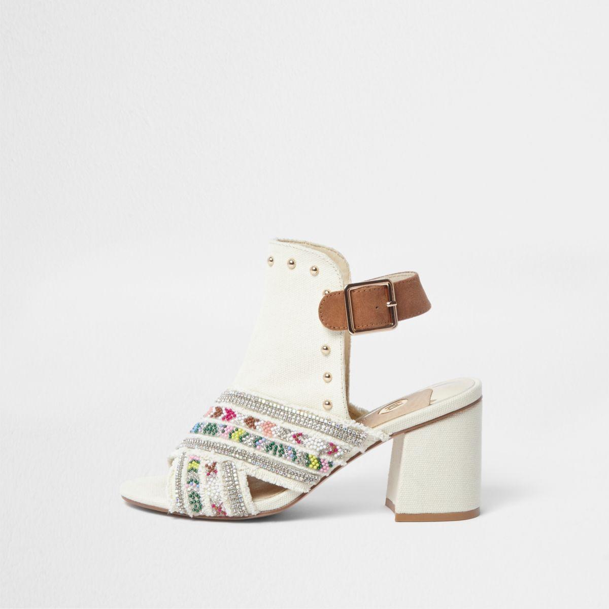 Cream embellished block heel shoe boots