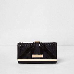 Black cut about panel clip top purse