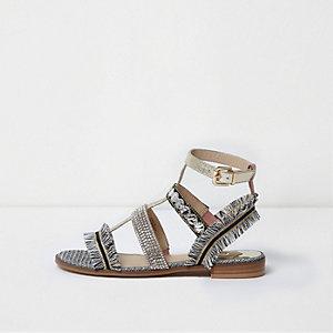 Sandales dorées métallisées effet cage à franges et strass