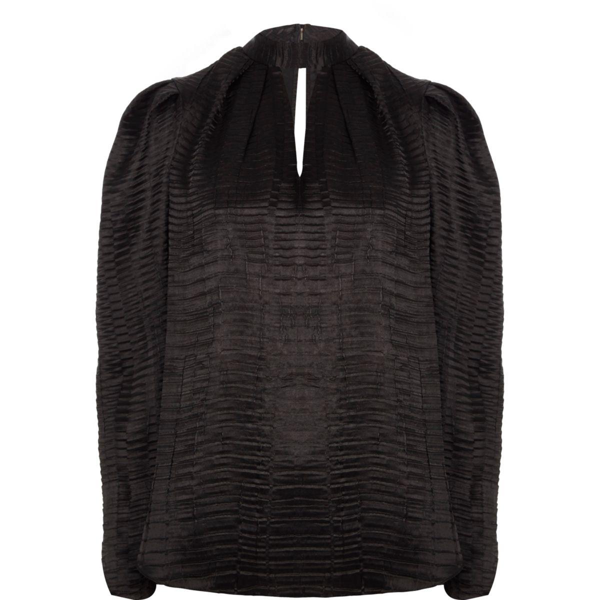 Top noir texturé à encolure haute et épaules bouffantes