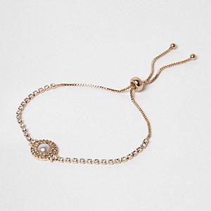 Gold tone diamante faux pearl lariat bracelet