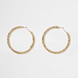 Gold tone beaded hoop earrings