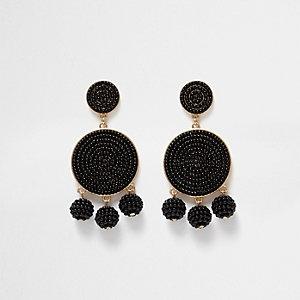 Pendants d'oreilles noirs à trois boules perlées