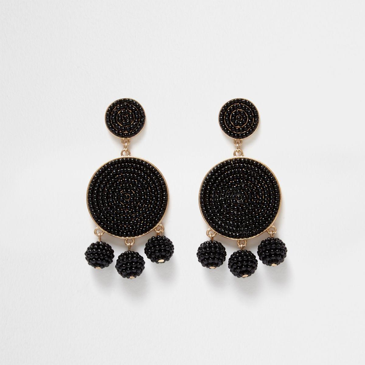 Zwarte oorhangers met drie ballen en kralen