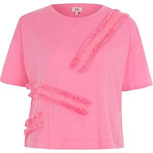 Roze ruimvallend T-shirt met biezen met franje