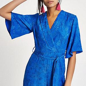 Blue jacquard wrap tie waist jumpsuit