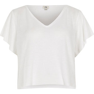 Wit cropped T-shirt met V-hals en wafeldessin