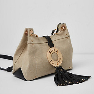 Beige canvas RI ring tassel cross body bag