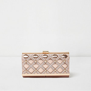 Nude pink cross metallic clip top purse