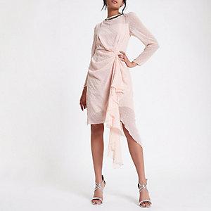 Roze jurk met versiering en flockprint stippen