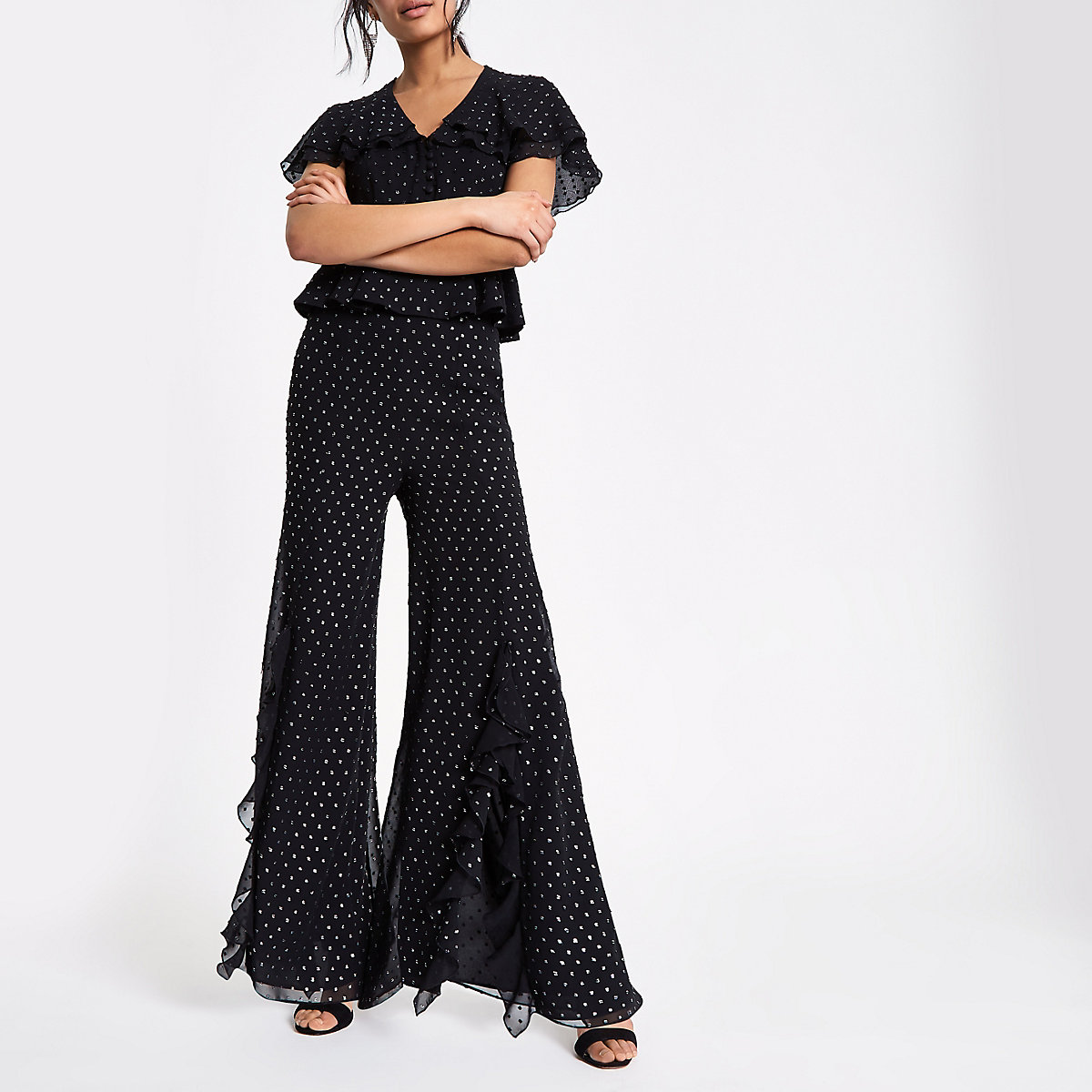 Black and silver split front frill pants