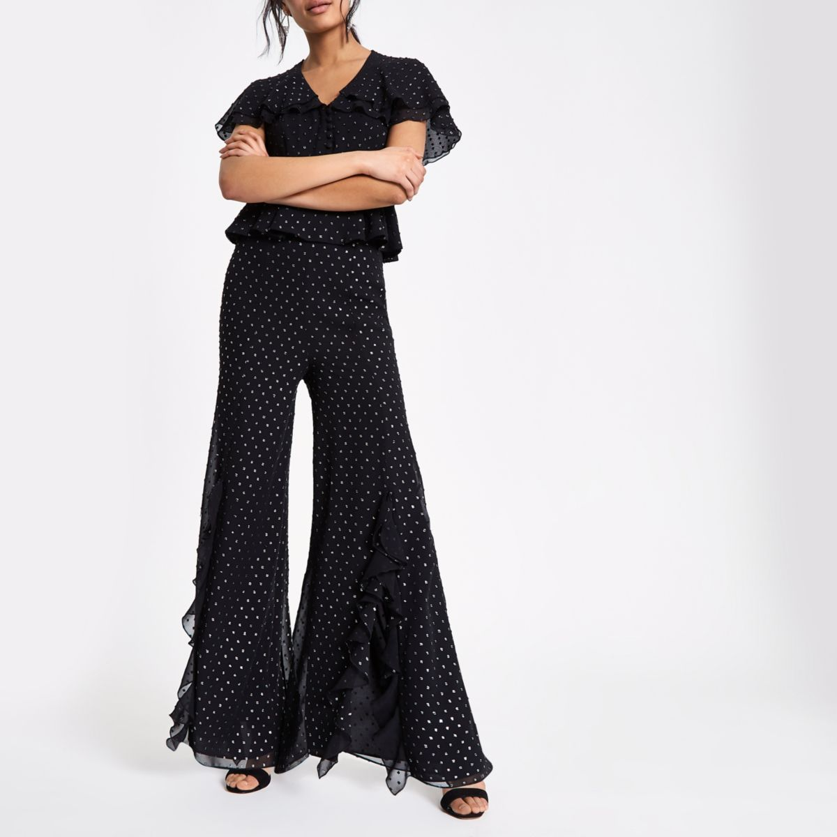 Black and silver split front frill trousers