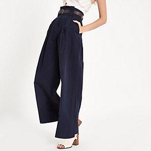Marineblauwe broek met wijde pijpen en geplooide taille