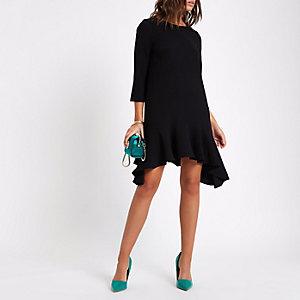 Schwarzes Swing-Kleid mit Schößchen