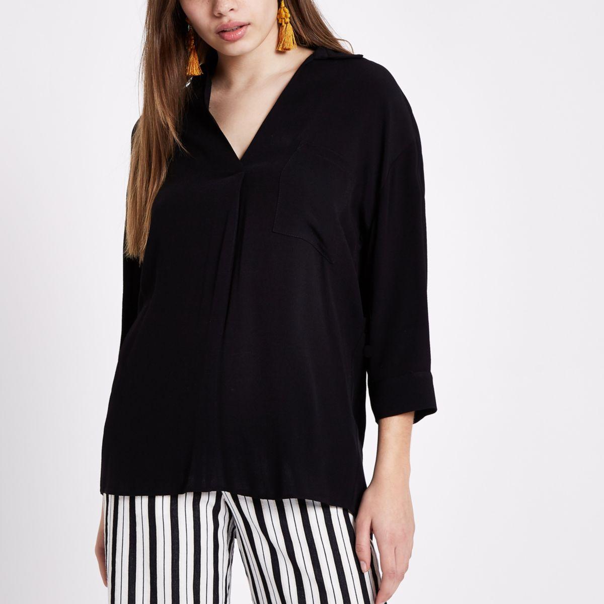 Zwarte blouse met gekruiste bandjes op de rug