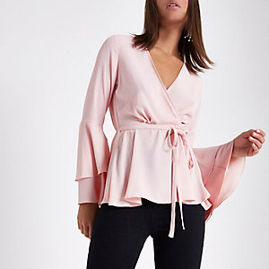 Light pink frill sleeve wrap blouse