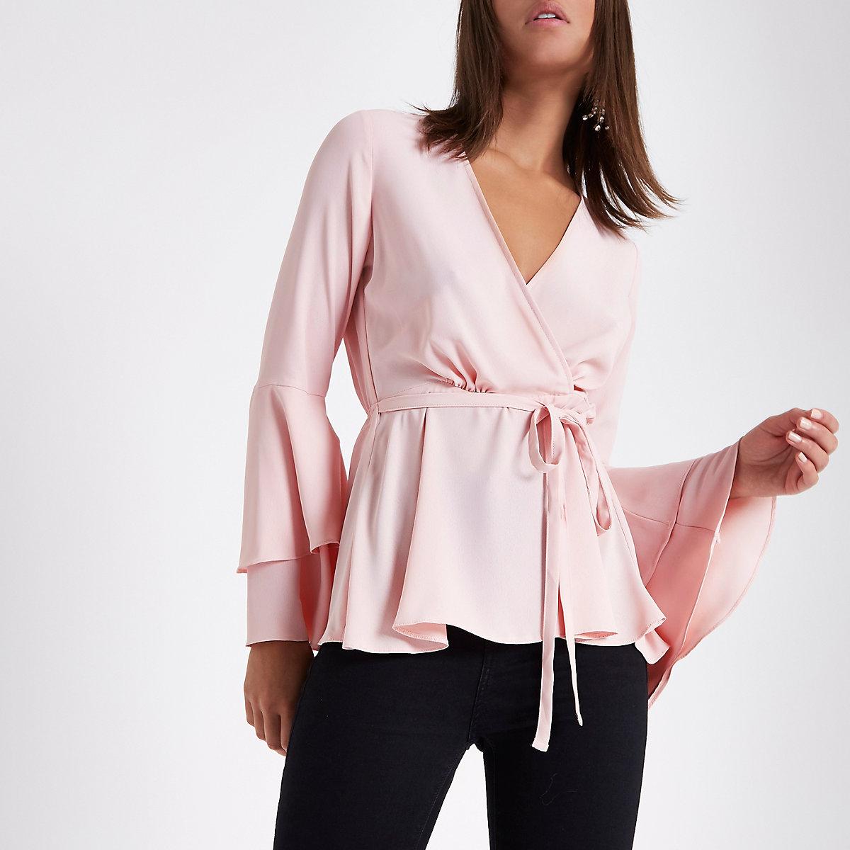 Light pink frill sleeve wrap blouse