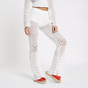 White crochet knit flare trousers