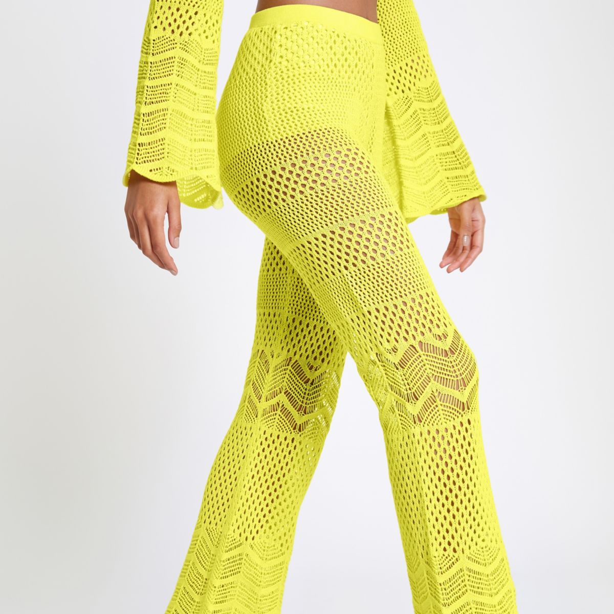 Yellow crochet knit flared trousers