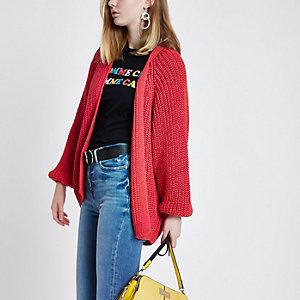Bright pink chunky knit cardigan