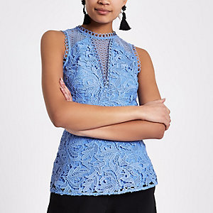 Blue lace sleeveless peplum top