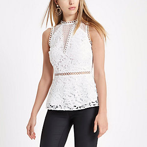 White lace sleeveless peplum top