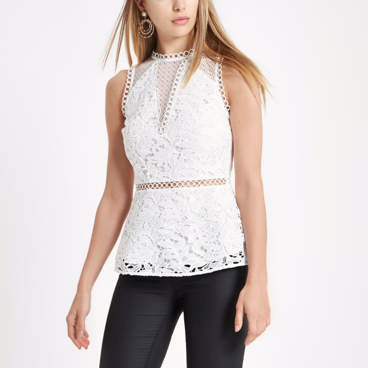 White lace sleeveless peplum top