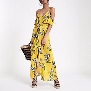 Robe longue jaune à fleurs avec épaules dénudées