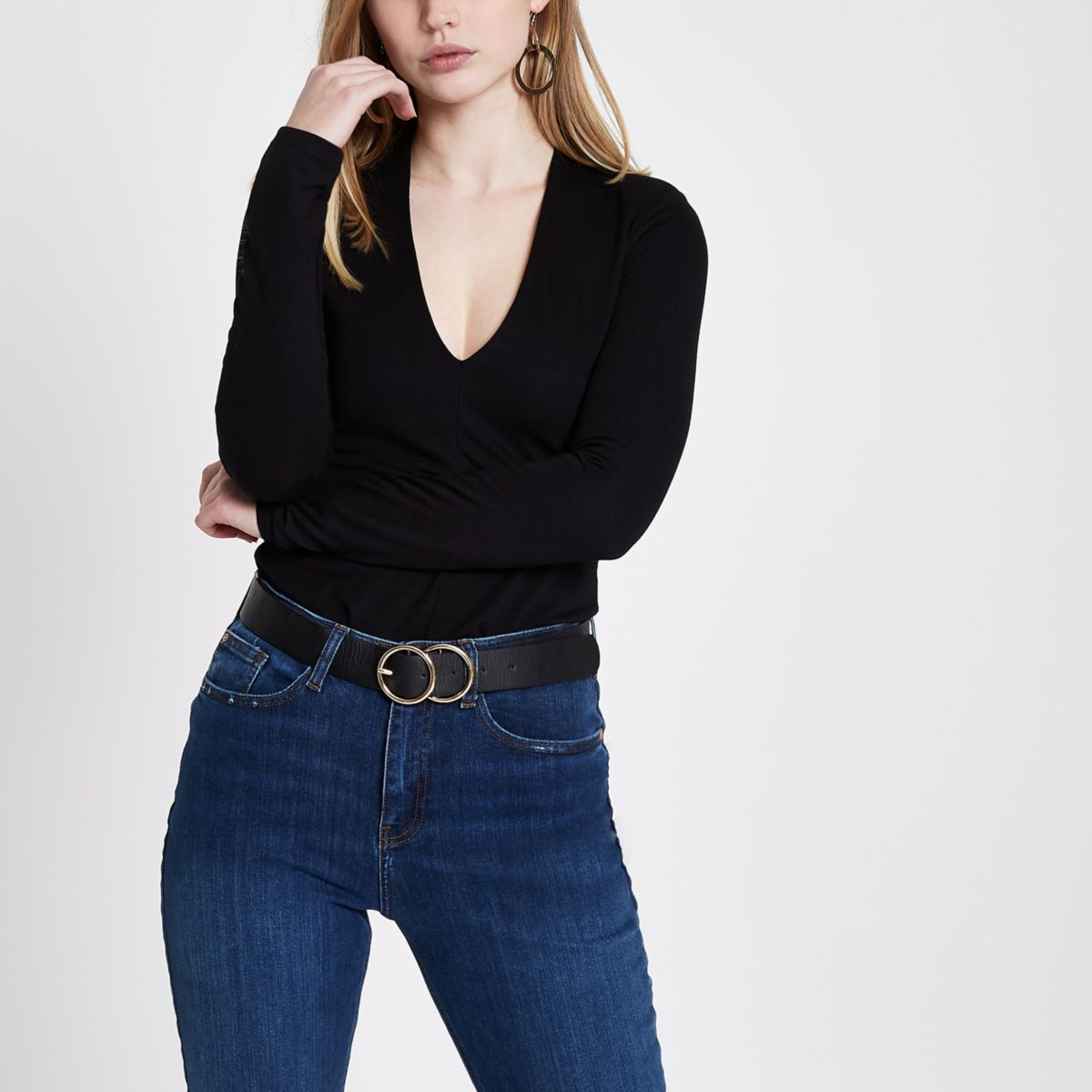 Black plunge neck shoulder pad top