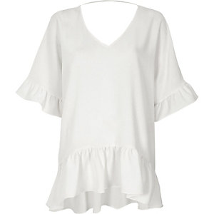 Cream frill sleeve V neck peplum hem top