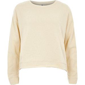Crème sweatshirt met franje en strik achter
