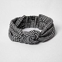 Zwarte hoofdband met pied-de-poule-motief en knoop voor