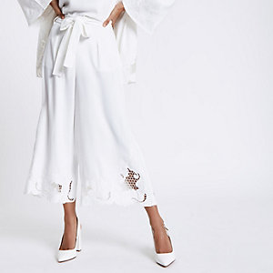 Petite white crochet hem wide leg trousers