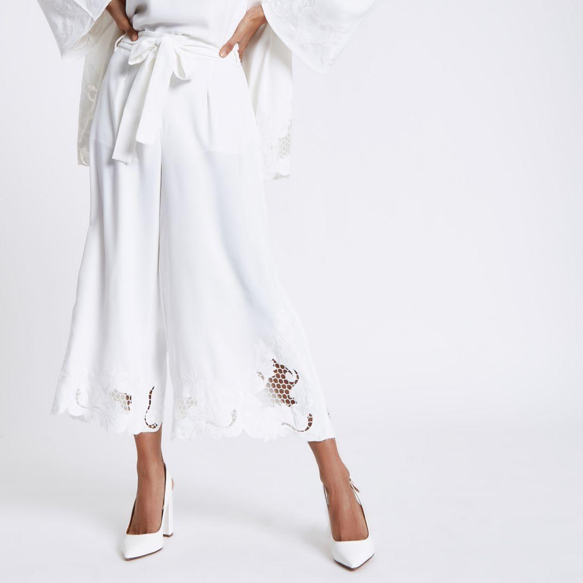 Petite white crochet hem wide leg trousers
