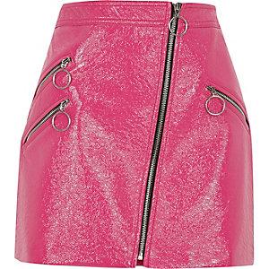 Mini jupe en vinyle rose à zips et anneaux