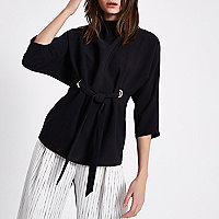 Black eyelet tie up front high neck top