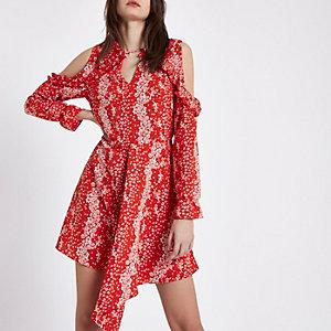Rode schouderloze gebloemde jurk met strikceintuur
