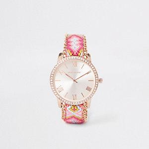 Montre ronde rose à strass et bracelet tissé
