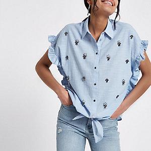 Blaue, verzierte Bluse mit Rüschen