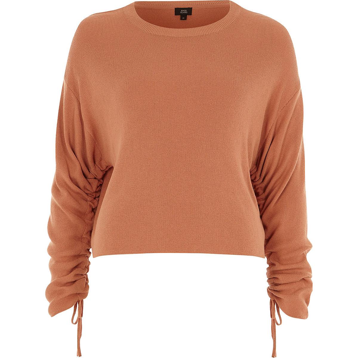 Light orange ruched long sleeve knit top