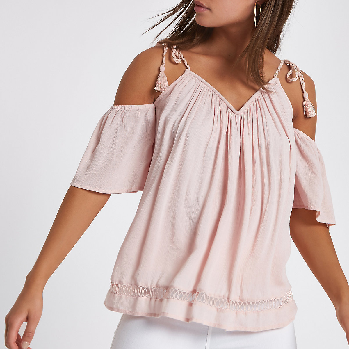 Light pink tassel cold shoulder top