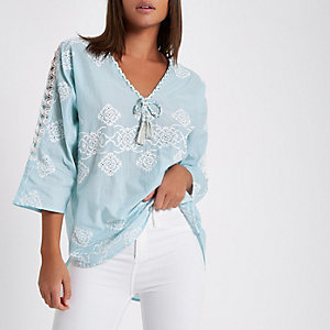Light blue lace tie neck smock top