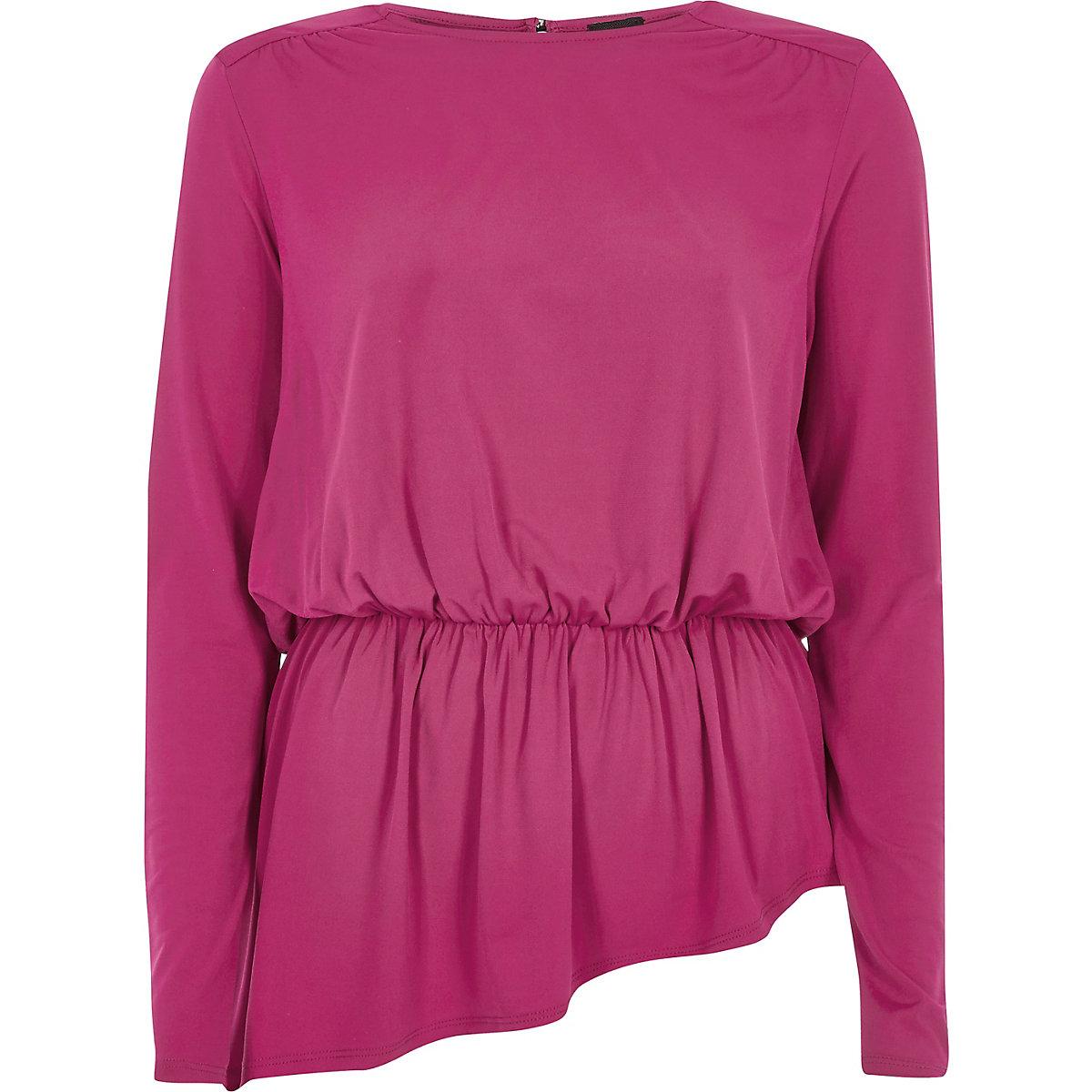 Roze top met brede schouders en peplum