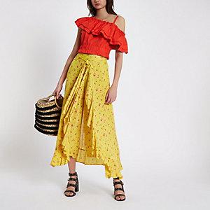 Gele broek met bloemenprint, overslag en strik