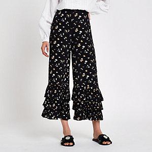 Jupe-culotte à fleurs noire avec ourlet à volant