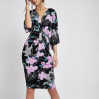 Robe mi-longue noire imprimé floral à manches chauve-souris