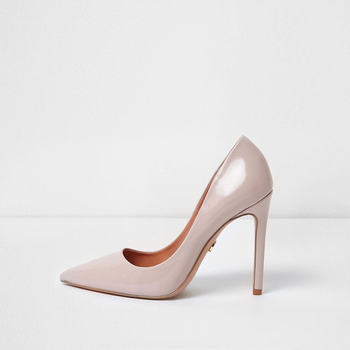 Light pink patent pumps