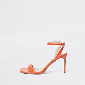 Sandales minimalistes orange à talon mi-haut