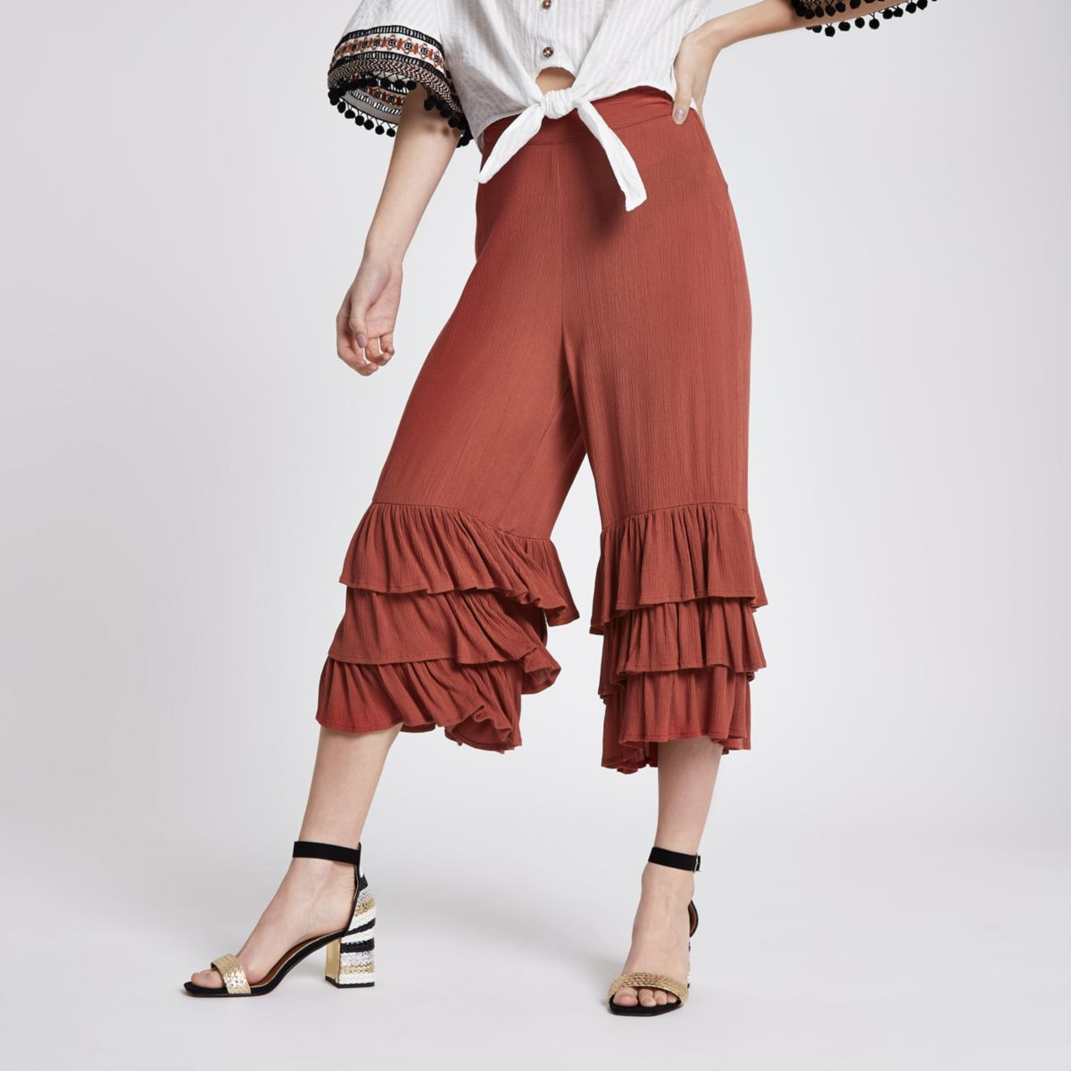 Petite rust red frill hem pants