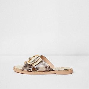 Goudkleurige sandalen met slangenprint en gekruiste bandjes